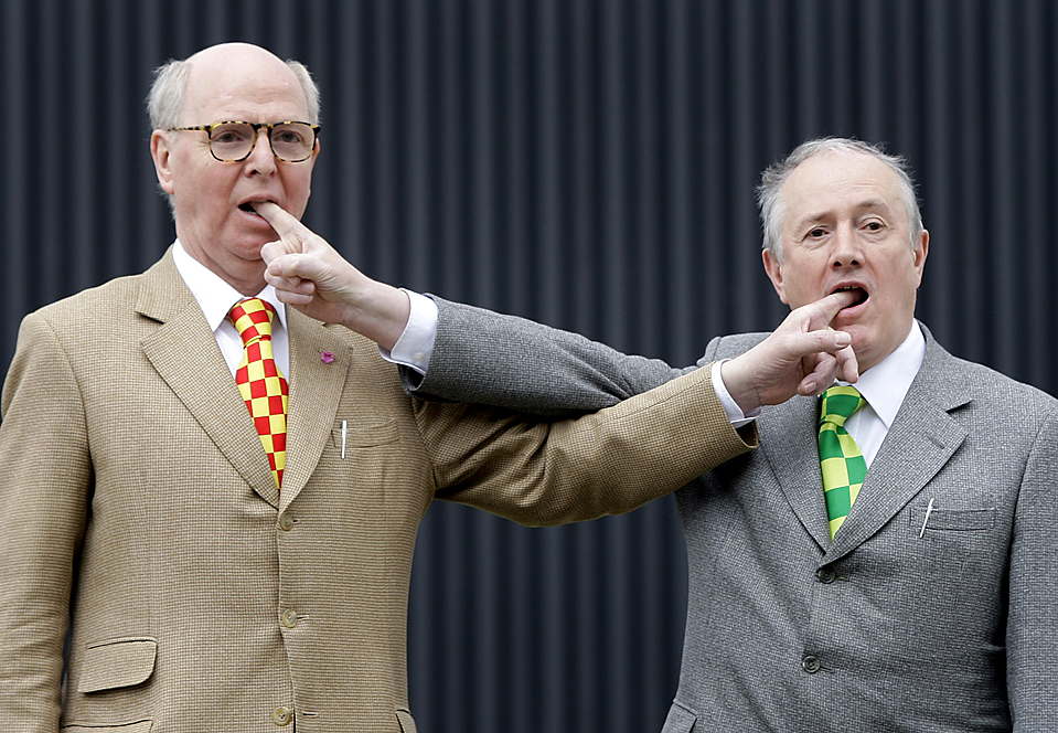 British artists Gilbert (R) and George (L) pose before a news conference to promote their latest show 'Jack Freak Pictures' in Berlin, June 12, 2009. The German gallery Arndt & Partner hosts the exhibition from June 16 till September 18 in the German capital. REUTERS/Tobias Schwarz (GERMANY ENTERTAINMENT IMAGES OF THE DAY)
